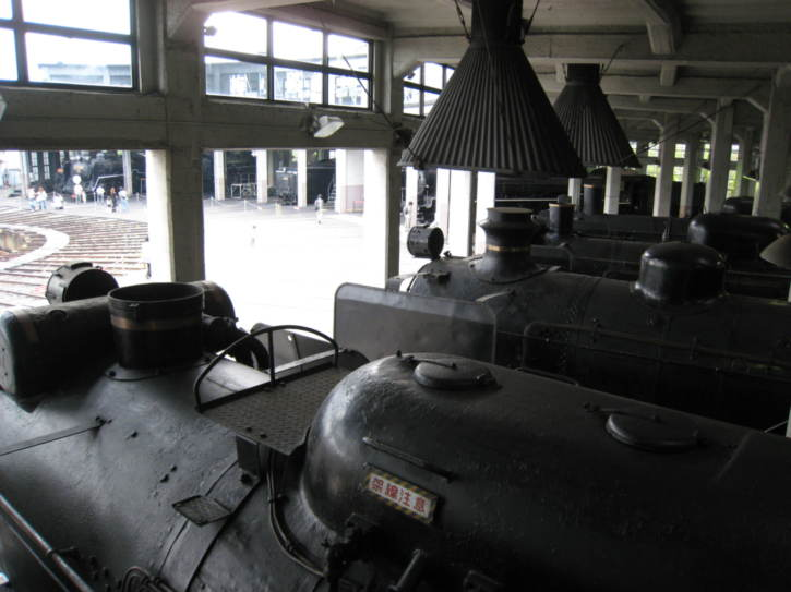 Looking over locomotives in the engine shed