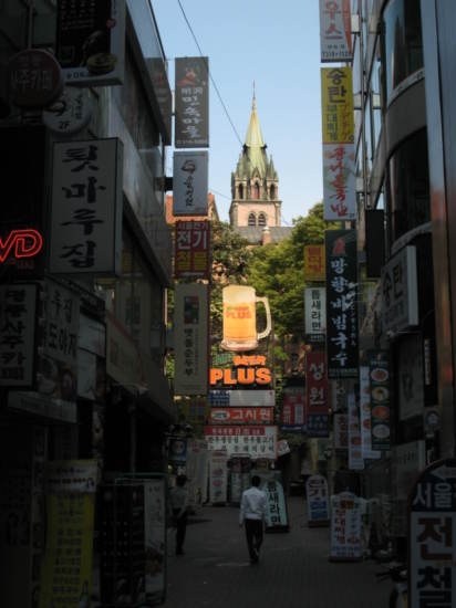 Myeong-dong Cathedral seen through a sea of consumerism