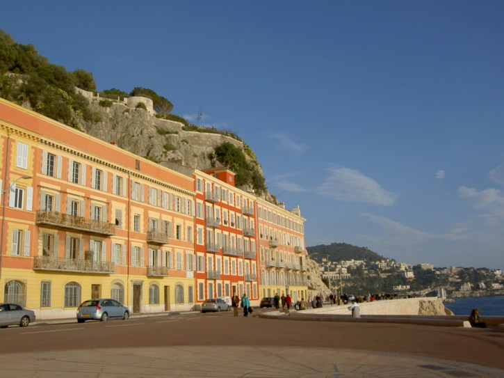 Nice colourful buildings set in front of rugged rocks