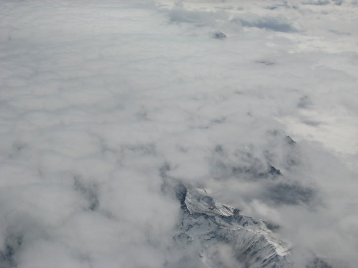 Mountains poke through the clouds