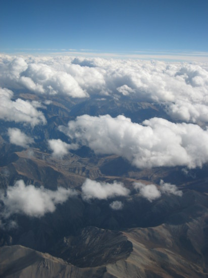 Barren Tibetan landscape seen through the clouds