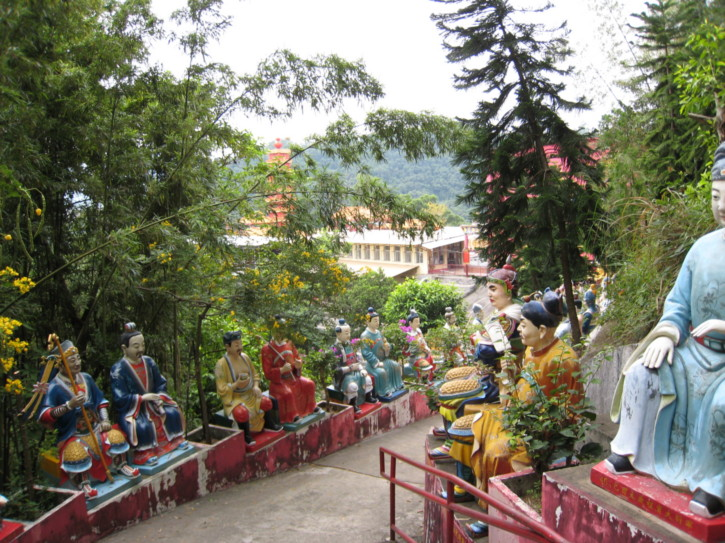 Colourful Buddhas on a path above the temple