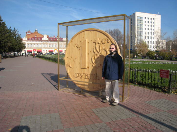 Me by a giant wooden ruble