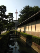 Higashi Hongan Temple moat with Kyoto Tower in the distance