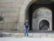 Me by a gate on the historical city wall