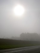 The sun and a hosue through the mist