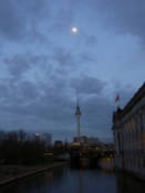 The TV tower points up to the moon