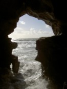 Looking out of the cave to the sea