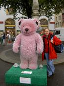 Mum standing with a pink teddy